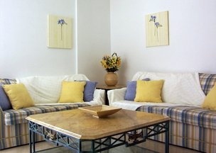 Blue and yellow lounge with fabric wall panels
