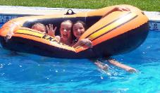 Girls with inflatable boat