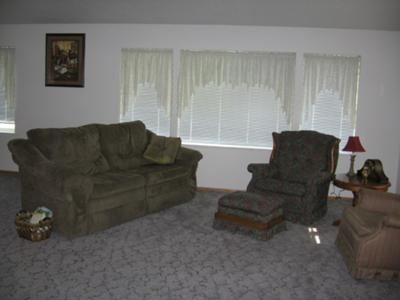 Gray Carpet,  Sage Furniture, White Walls