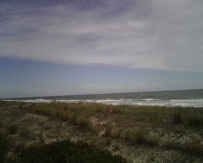 A dusky sea, sand, and sky shot my father took.