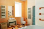 contemporary peach and white bathroom