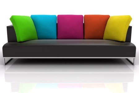 contemporary black and chrome sofa with multi colored cushions - green blue pink orange yellow
