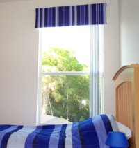 Blue striped padded pelmet