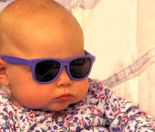 Traveling Baby wearing sunglasses