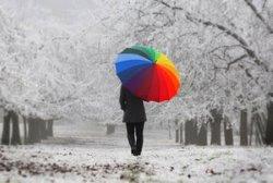 Man with rainbow umbrella